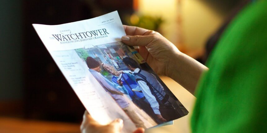 Woman reading Watchtower magazine
