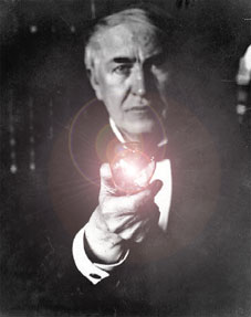 Thomas Edison holding light bulb