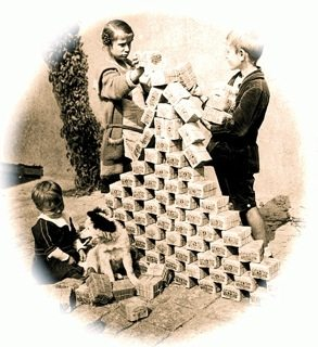 German children play with bundles of worthless Reichsmarks