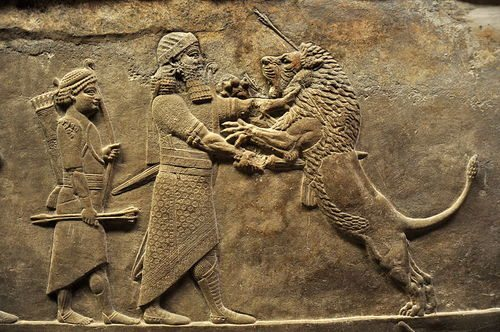 assyrian relief warrior on lion hunt