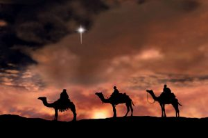 Chaldean magi on camelback travel to see the infant Jesus