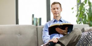 Man reading Bible - Watchtower image
