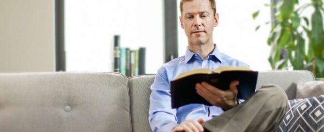 Man reading Bible - Watchtower image