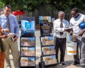 Jehovah's Witnesses on the street with information carts