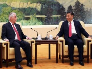 Rex Tillerson and president of China sit